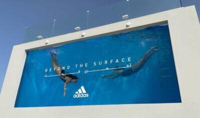 """Adidas sceglie una piscina al posto della classica locandina per promuovere la campagna """"Beyond the Surface"""""""